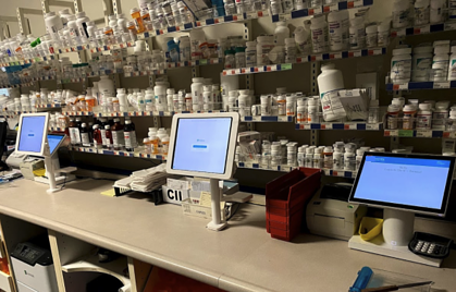 Pharmacy counter space is neat and organized